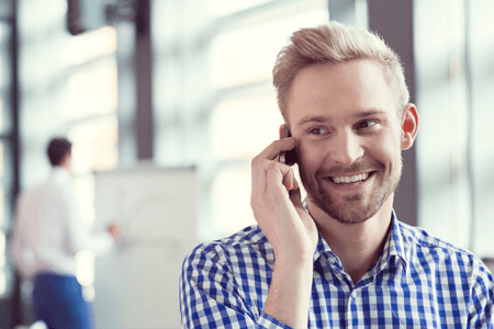 Man Smiling On Phone