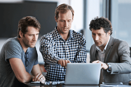 3 Men Pointing At Laptop Screen