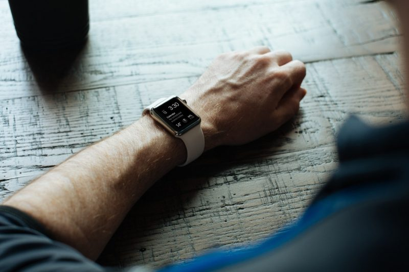 man with smart watch on wrist